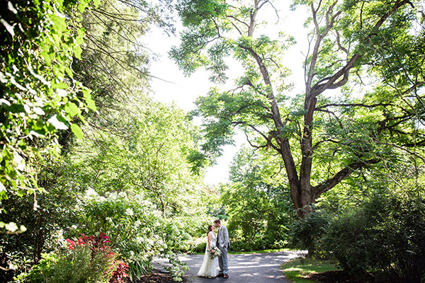a bride and groom kissing under a tree at this york pa wedding venue