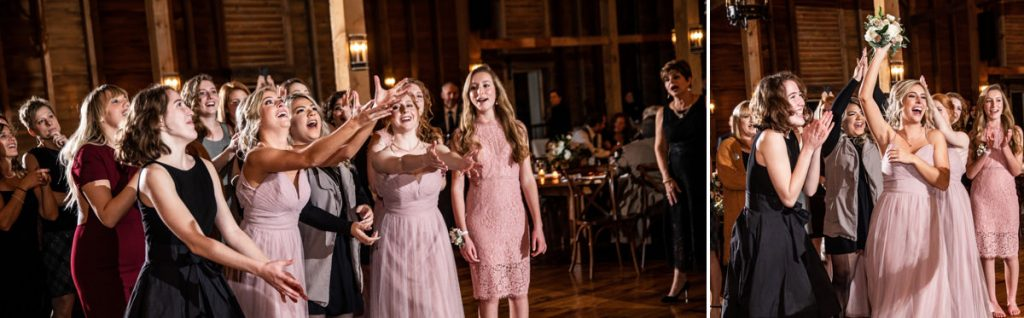 A group of bridesmaids trying to catch the bridal bouquet after the bride tossed it during the wedding reception.