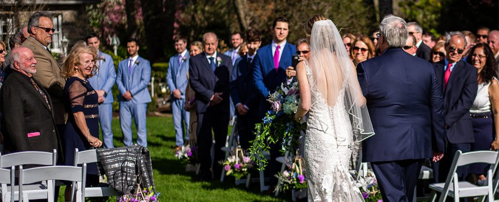 A bride doing the bridal processional at her wedding to one of her favorite songs.