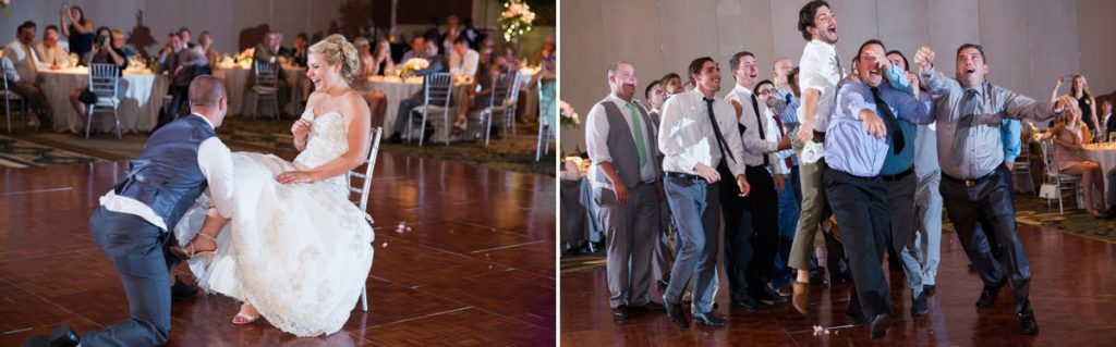 A funny song is playing during the garter removal. This photo shows a groom removing the garter and a bunch of single guys trying to catch it after the groom tossed it to them.