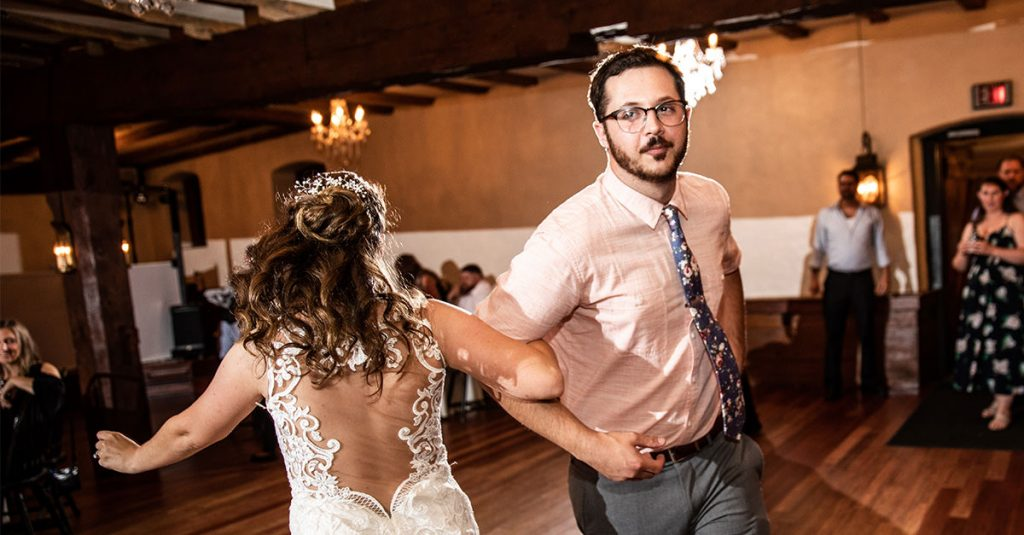 A bride dancing with her brother at the wedding