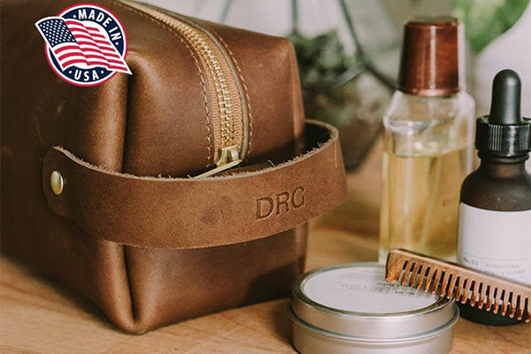 A personalized leather dopp kit sitting on a table