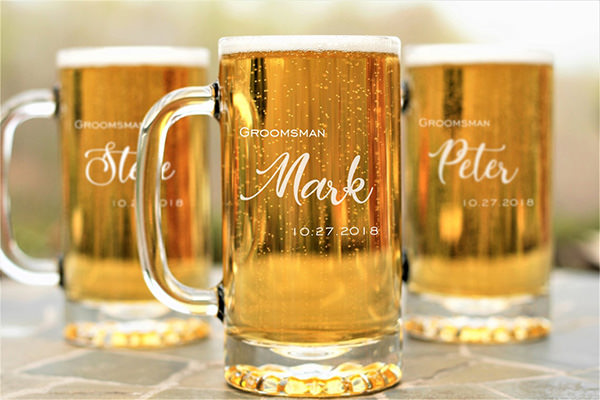 3 engraved beer mugs sitting on a table