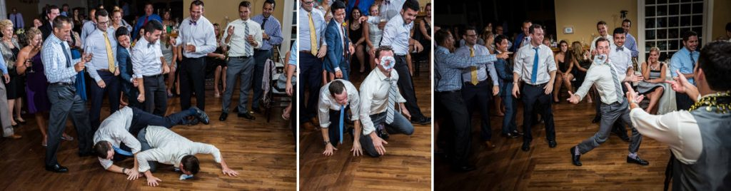 A bunch of rowdy wedding guests diving for the garter after the groom tossed it to them. They removed the garter to a really funny song.