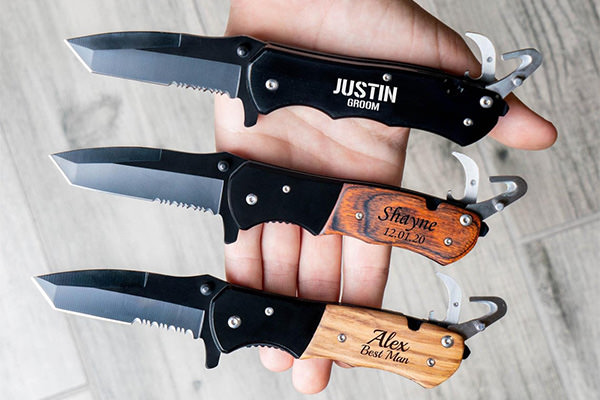 3 pocket knives that are gifts for groomsmen. They are engraved.