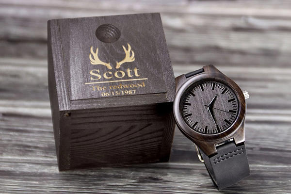 A watch and box sitting on a table