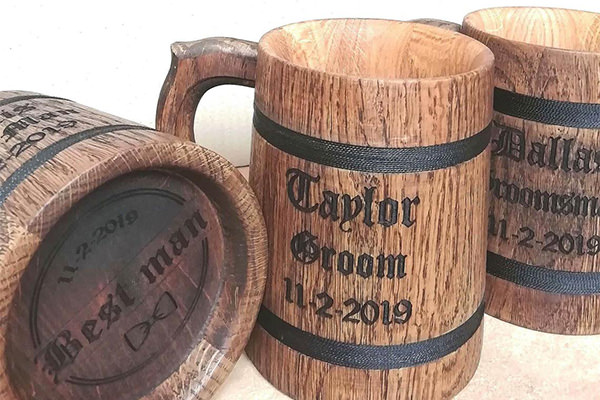 cool wooden beer mug used for groom or groomsmen gift. The photo shows 3 of them.