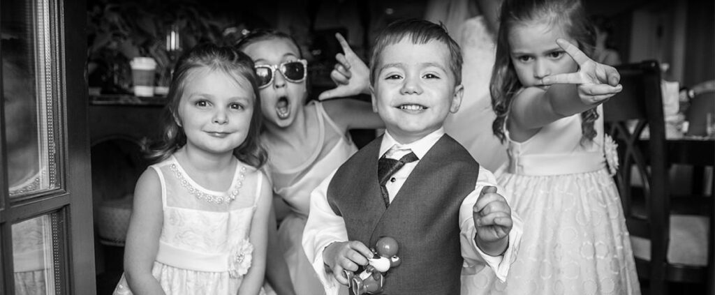 The flower girls and ring bearer having fun before the wedding.