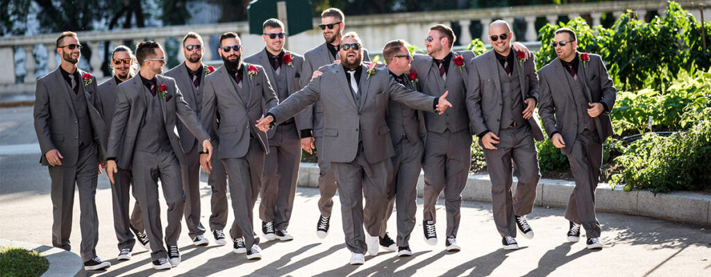 The groom and groomsmen walking.