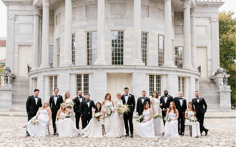 A wedding party posing in Philadelphia. This photo is one of the cover photos for the best Philadelphia wedding photographers article.