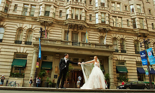 A bride and groom posing in downtown Philly