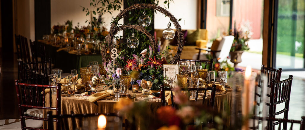 A decorated table at a wedding reception
