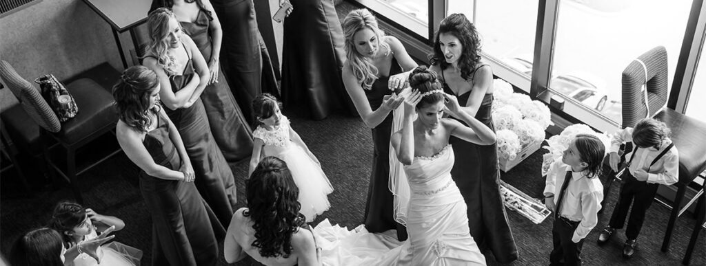 The bride getting her dress on. Another important photo that should be on your wedding photography shot list.