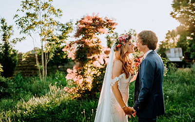 A bride and groom kissing at sunset after their bucks county pa wedding
