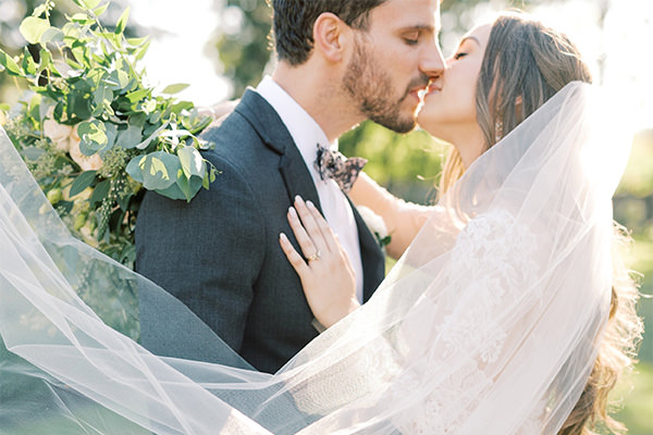 A bride and groom kissing. This is for the bucks county pa wedding photographers article.