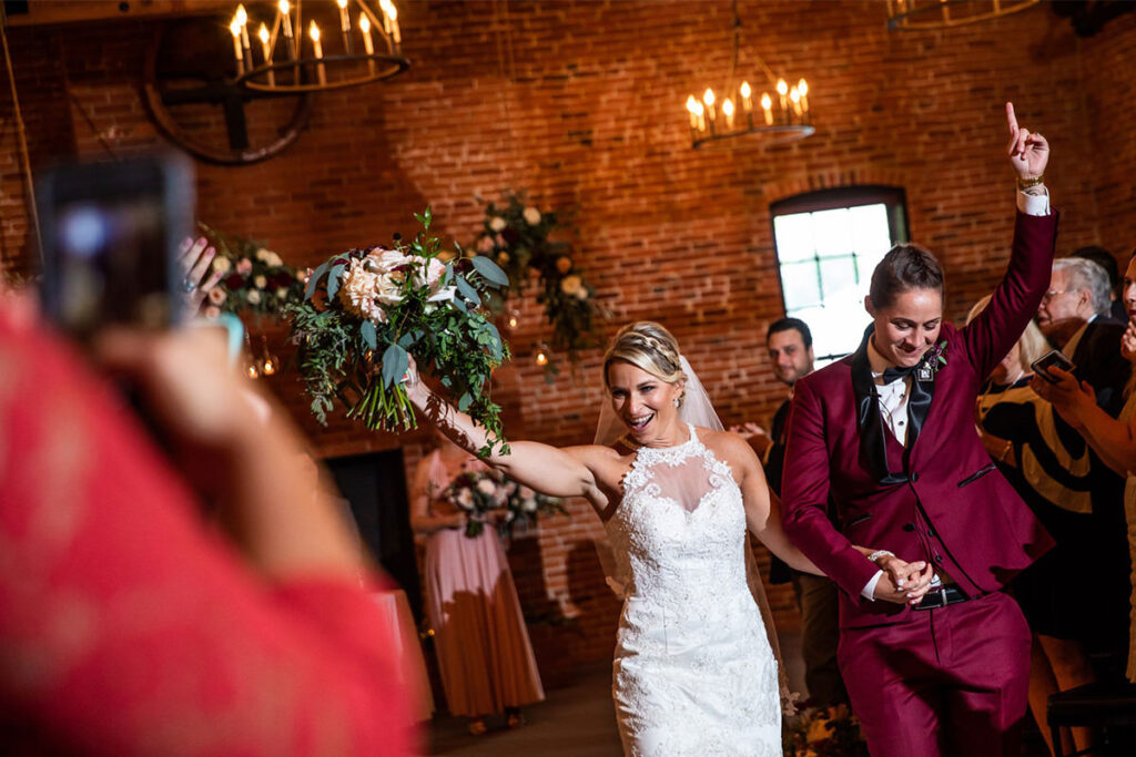 Two brides walking down the aisle after being married near Harrisburg Pennsylvania