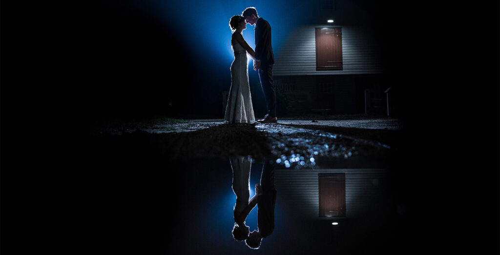 A bride and groom at night. This is for the article called how long does it take to get wedding photos back from the photographer?