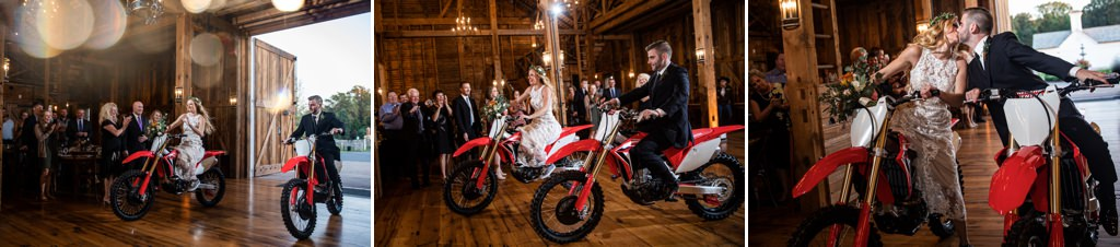 A bride and groom riding into their wedding reception on dirt bikes.