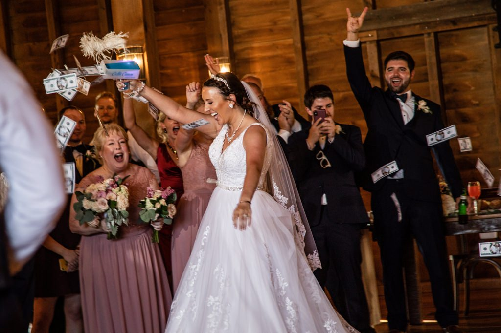 A bride making it rain with money during the grand entrance at the wedding reception.