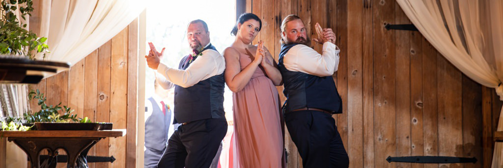 A wedding party doing the Charlie's Angles pose