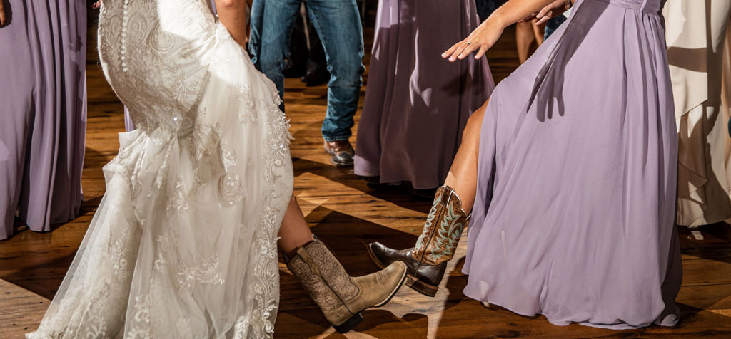 Cowboy boots on the dance floor at a wedding.