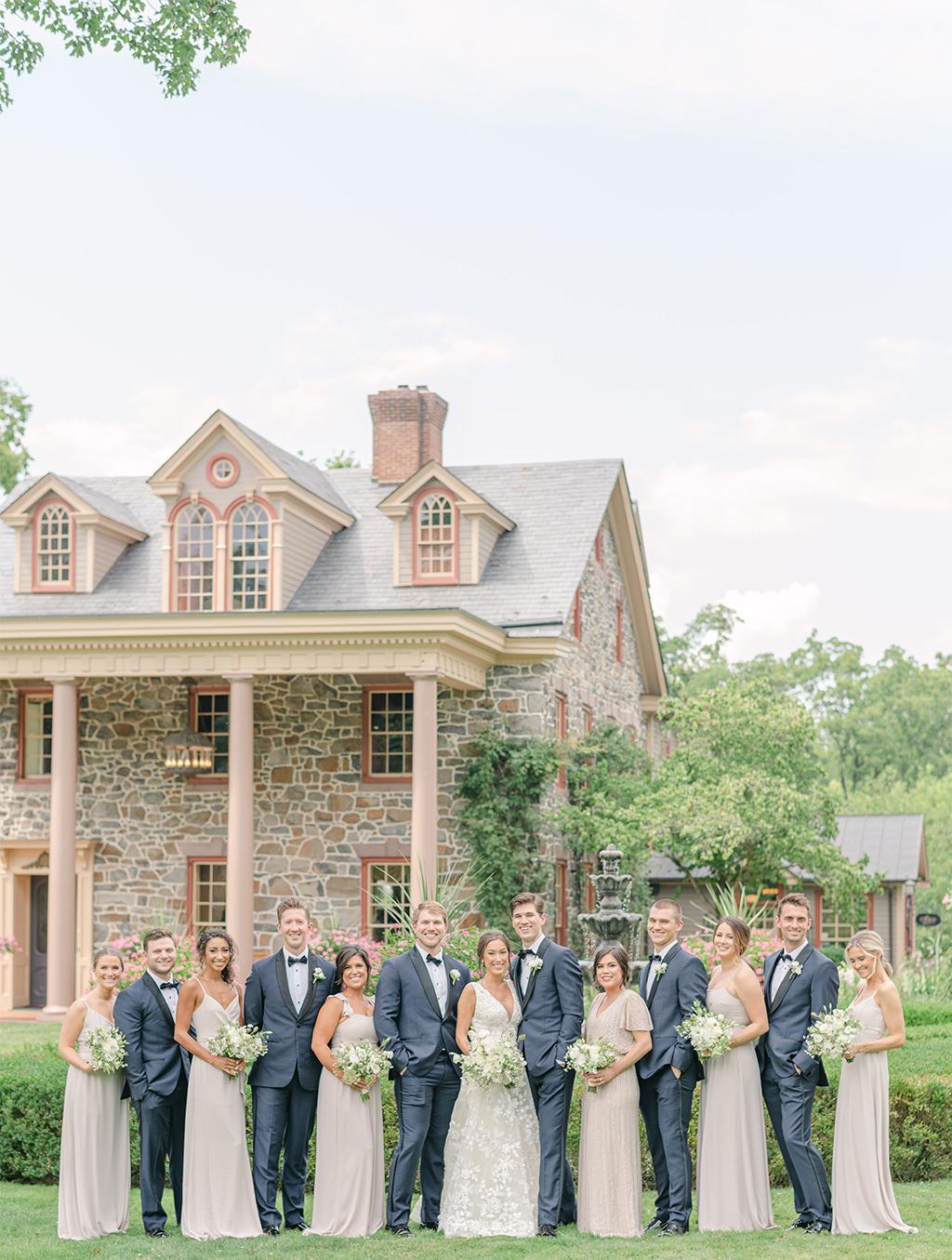 A bridal party posing outside Moonstone Manor