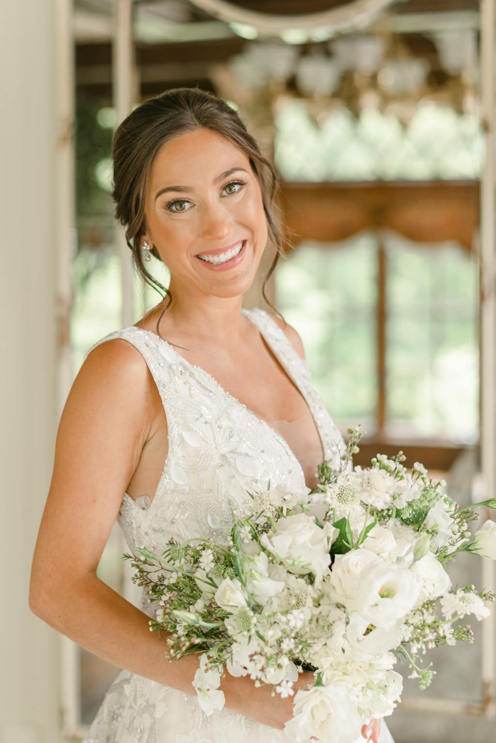 A bride smiling just before her Moonstone Manor wedding.