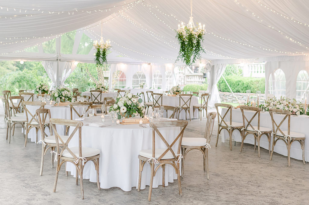 Wedding reception decor at Moonstone Manor. A wide photo of the all of the tables and chairs
